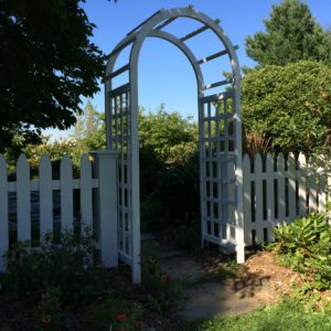 White gothic picket with cedar arbor