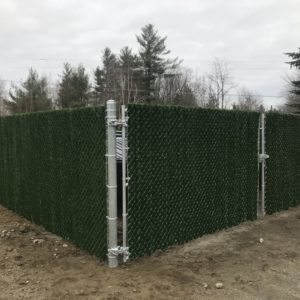 Dumpster Enclosure with Green Hedge Slats